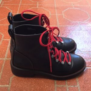 Black combat boot with red laces